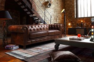 canape chesterfield dans un salon - decoration interieure